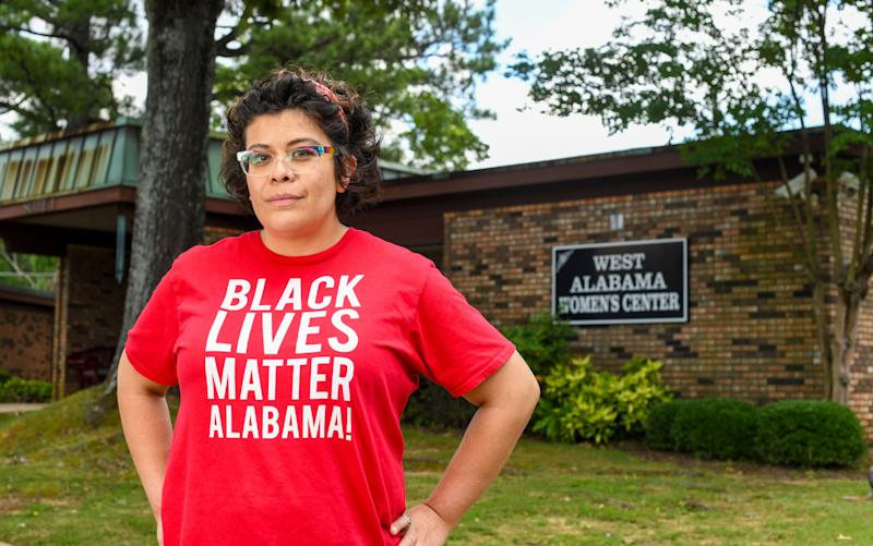 Activist Amanda Reyes stands outside West Alabama Women's Center on June 5. Reyes started the Yellowhammer Fund, which raised millions of dollars for abortion access and was able to purchase the last abortion clinic in west Alabama. (Photo: Julie Bennett for HuffPost)