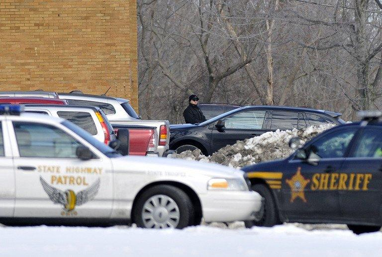 Police cars are parked in Chardon, Ohio on February 27, 2012