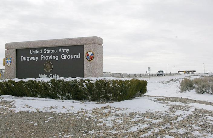A truck approaches the main gate at the US Army's Dugway Proving Ground in the middle of Rush Valley in Utah December 17, 2001.
