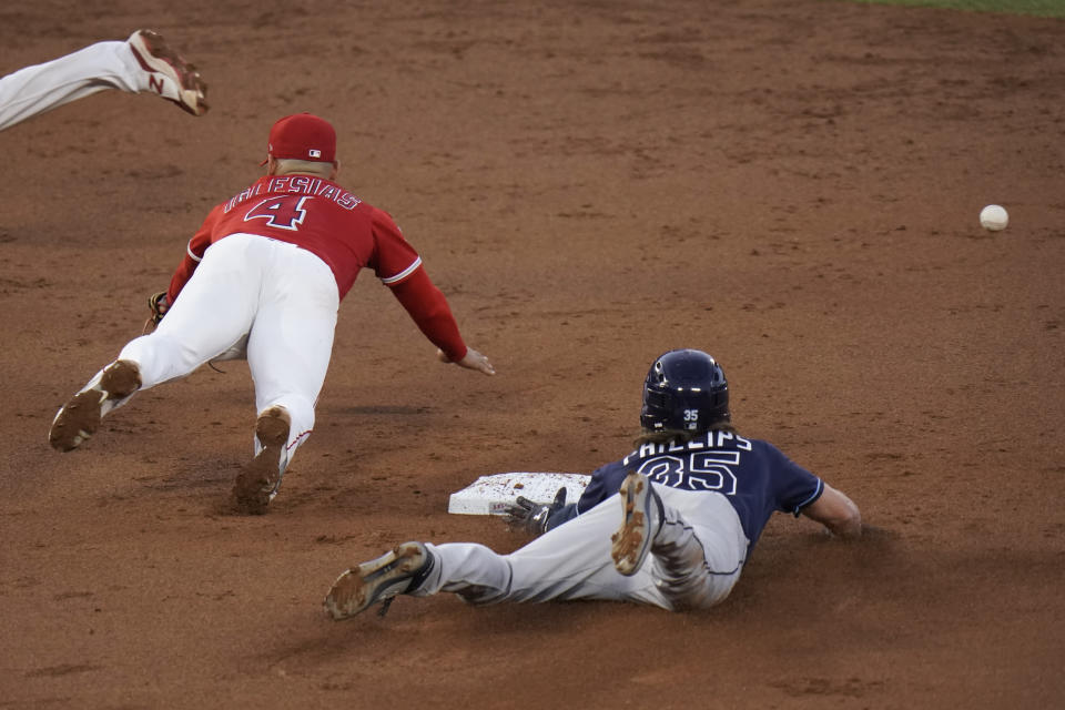 Tampa Bay Rays' Brett Phillips, right, steals second base as Los Angeles Angels' Jose Iglesias misses the throw during the third inning of a baseball game Thursday, May 6, 2021, in Anaheim, Calif. Phillips advanced to third on the errant throw. (AP Photo/Jae C. Hong)