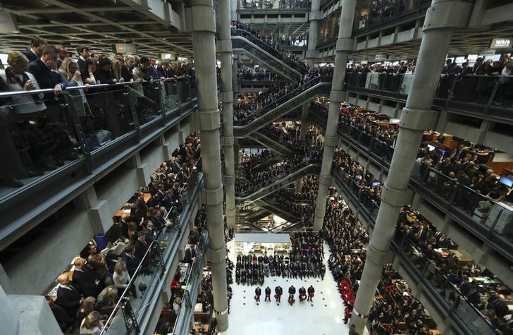 Lloyd's of London staff hold their annual Armistice Day service at the Lloyd's building in the City of London, Britain November 11, 2016. REUTERS/Eddie Keogh