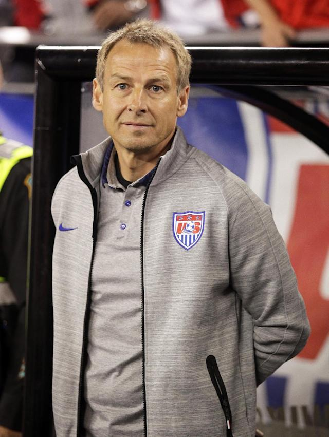 U.S. head coach Jurgen Klinsmann before a game against Mexico during an international friendly soccer match Wednesday, April 2, 2014, in Glendale, Ariz. The game ended in a 2-2 draw. (AP Photo/Rock Scuteri)