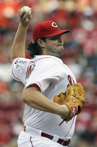 Cincinnati Reds starting pitcher David Holmberg throws against the Chicago Cubs in the first inning of a baseball game, Tuesday, July 8, 2014, in Cincinnati. (AP Photo/Al Behrman)
