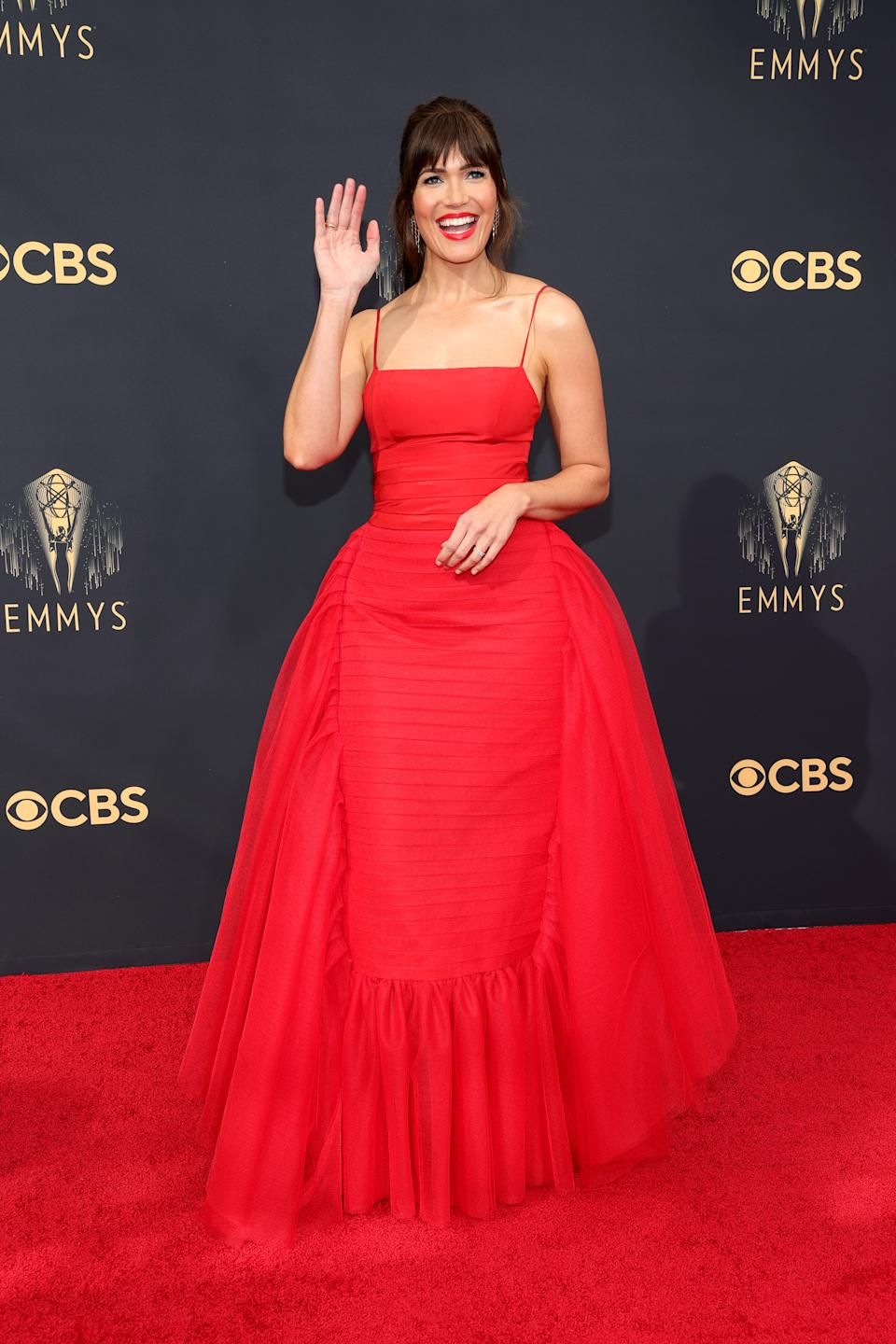Mandy Moore wears a red dress by Carolina Herrera at the 73rd Primetime Emmy Awards at L.A. LIVE on September 19, 2021 in Los Angeles, California. (Photo by Rich Fury/Getty Images)