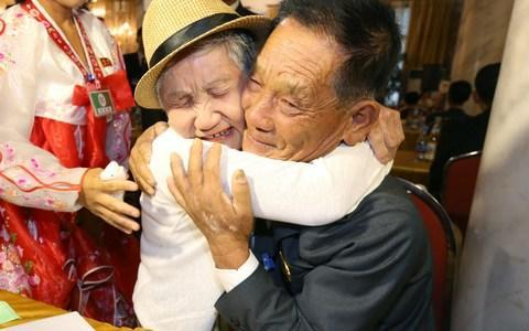 <span>South Korean Lee Keum-seom, 92, meets her North Korean son Ri Sung Chol, 71</span> <span>Credit: AFP/AFP </span>