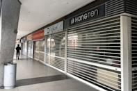 Shops seen closed at the Peninsula Plaza mall on 7 April 2020, the first day of Singapore's month-long circuit breaker period. (PHOTO: Dhany Osman / Yahoo News Singapore)