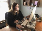 Abby Hoover, Managing Editor of The Northeast News works at her desk in Kansas City, Mo. on Wednesday, March 31, 2021. The paper chose to leave the front page of their March 24 issue blank to show community members what they'd miss if the newspaper folded. (The Northeast News via AP)