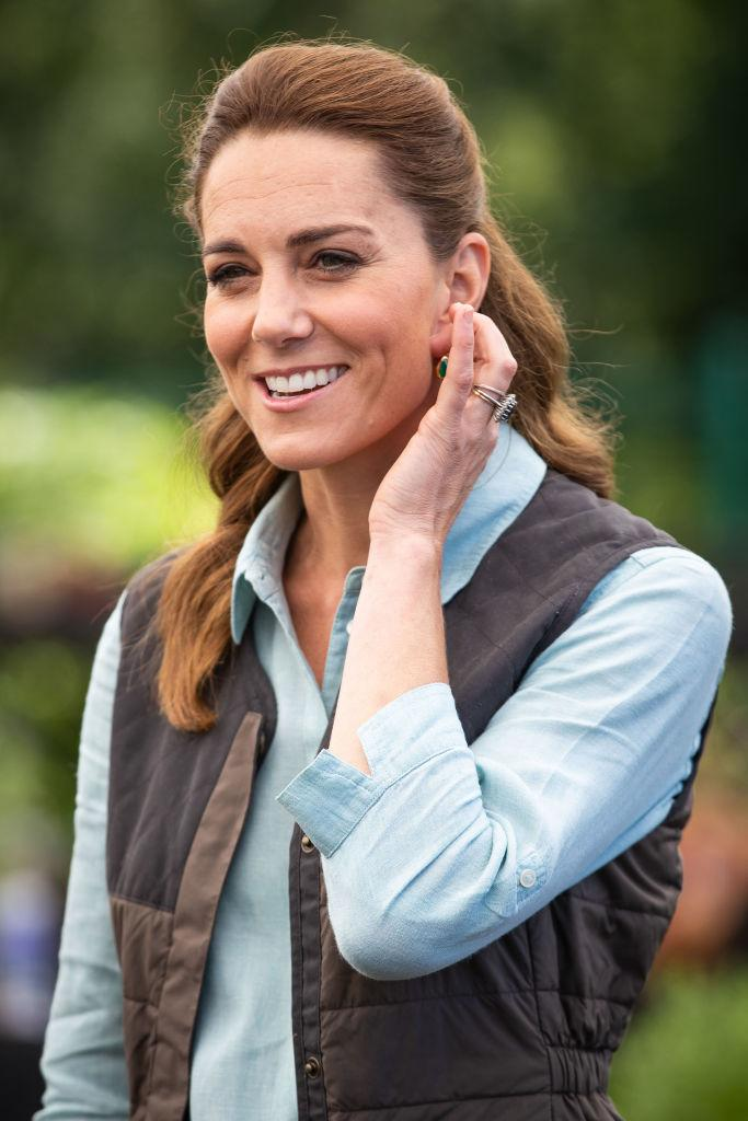 Last week the Duchess appeared to have more coppery tones in her hair, pictured at Fakenham Garden Centre. (Getty Images)