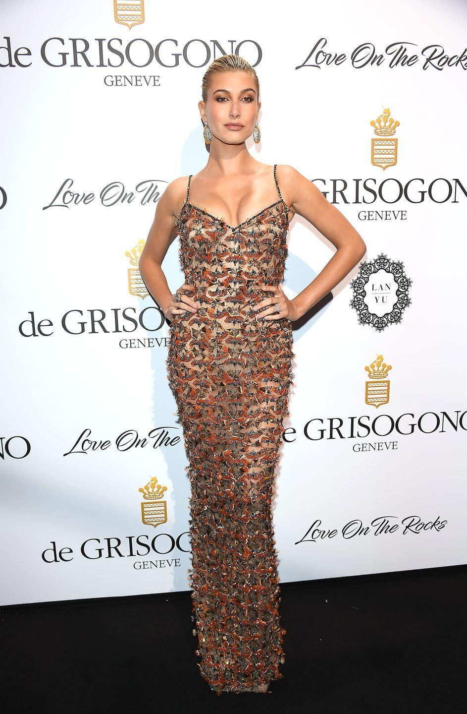 "<p>Hailey Baldwin<span class=""redactor-invisible-space""> wore an embellished Roberto Cavalli couture gown to attend the DeGrisogono 'Love On The Rocks' party.</span></p>"