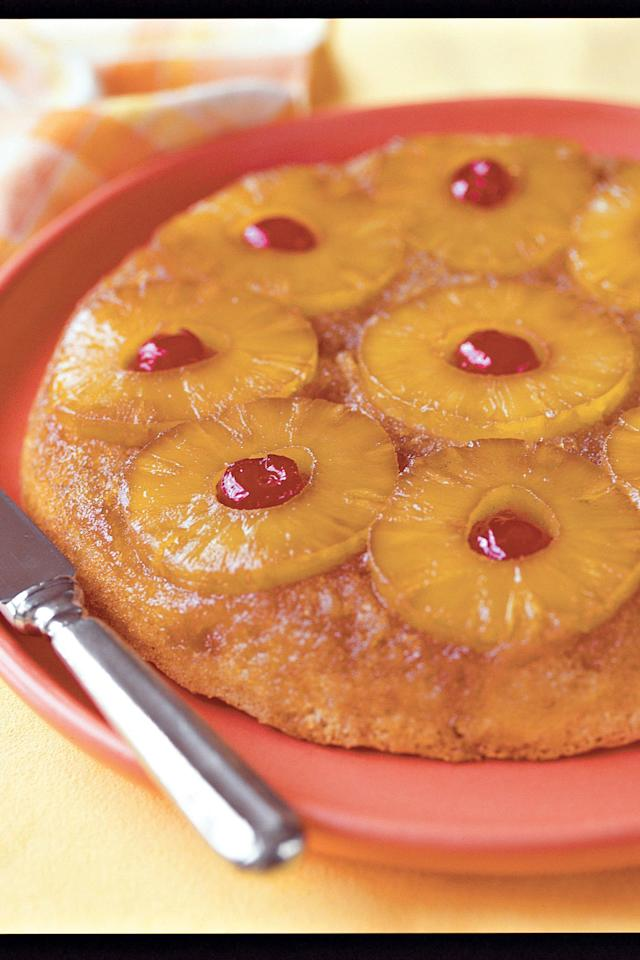 "<p><strong>Recipe: <a href=""http://www.myrecipes.com/recipe/skillet-pineapple-upside-down-cake"" target=""_blank"">Skillet Pineapple Upside-Down Cake</a></strong></p> <p>This top-rated upside-down cake features pineapple slices browned in butter in the bottom of the skillet and then topped with a rich cake batter. If you are short on time, try the express version of the recipe that uses cake mix.</p>"