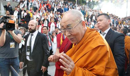FILE PHOTO: Tibetan spiritual leader the Dalai Lama arrives for his visit to the Tibet Institute Rikon in Rikon, Switzerland September 21, 2018.  REUTERS/ Arnd Wiegmann