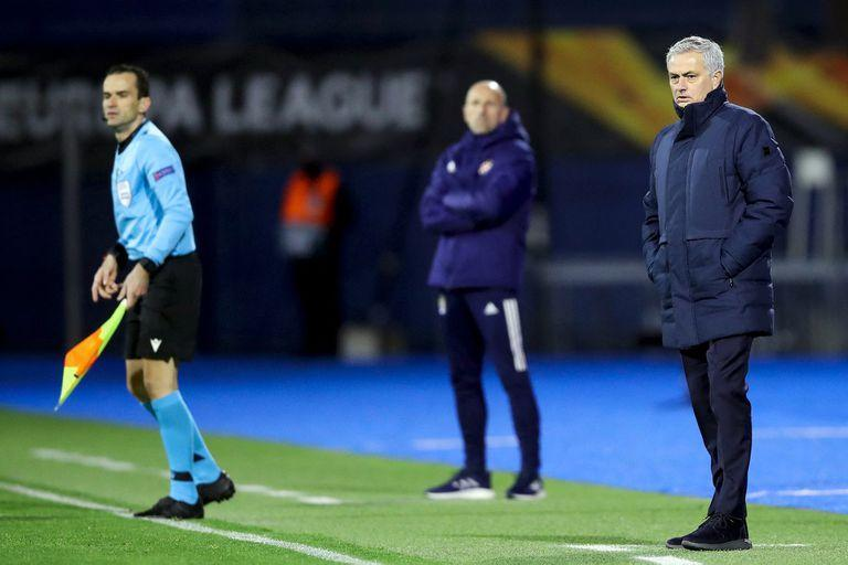 Tottenham's Portuguese coach Jose Mourinho (R) looks on during the UEFA Europa League round of 16 first leg football match between Dinamo Zagreb and Tottenham Hotspur at the Maksimir Stadium in Zagreb, on March 18, 2021. (Photo by Damir SENCAR / AFP)
