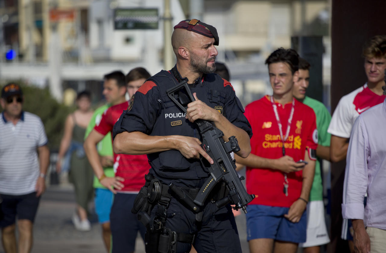 <p>An armed policeman grimaces while on patrol in Cambrils, Spain, Friday, Aug. 18, 2017. (Photo: Emilio Morenatti/AP) </p>