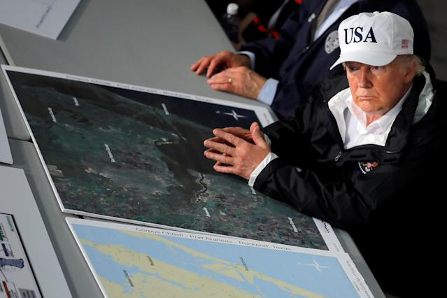 <p>President Donald Trump receives a briefing on Tropical Storm Harvey relief efforts in Corpus Christi, Texas, Aug. 29, 2017. (Photo: Carlos Barria/Reuters) </p>