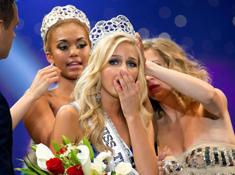 FILE - In this Saturday, Aug. 10,2013 file photo, Miss California Teen USA 2013, Cassidy Wolf, is crowned Miss Teen USA 2013. The FBI is investigating allegations that someone tried to extort nude photographs from the newly crowned Wolf, after hacking into a webcam in her Southern California bedroom. (AP Photo/Miss Universe L.P., LLLP, File)