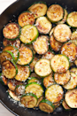 """<p>Most days, we don't have time to make an elaborate side dish, and something simple is all we crave. This easy, quick-sautéed courgette is the perfect side dish for those nights. It's full of flavour, and the courgette slightly caramelises as it cooks in the cast-iron pan. It's our favourite way to use up zucchini (beside <a href=""""https://www.delish.com/uk/cooking/recipes/a28961505/zucchini-chocolate-chip-cookies-recipe/"""" rel=""""nofollow noopener"""" target=""""_blank"""" data-ylk=""""slk:Courgette Chocolate Cookies"""" class=""""link rapid-noclick-resp"""">Courgette Chocolate Cookies</a>, of course) and you can catch us eating it as our lunch almost weekly. </p><p>Get the <a href=""""https://www.delish.com/uk/cooking/recipes/a32233248/sauteed-zucchini-recipe/"""" rel=""""nofollow noopener"""" target=""""_blank"""" data-ylk=""""slk:Garlic-Parm Courgette Sauté"""" class=""""link rapid-noclick-resp"""">Garlic-Parm Courgette Sauté</a> recipe.</p>"""