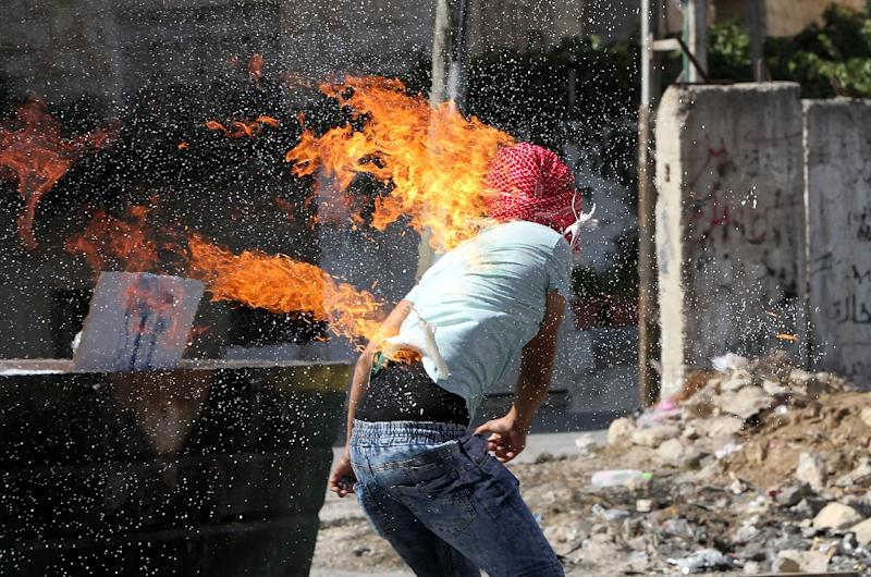 A Palestinian student accidentally sets himself on fire while throwing a Molotov cocktail towards Israeli soldiers during clashes near the West Bank town of Hebron, on October 13, 2015