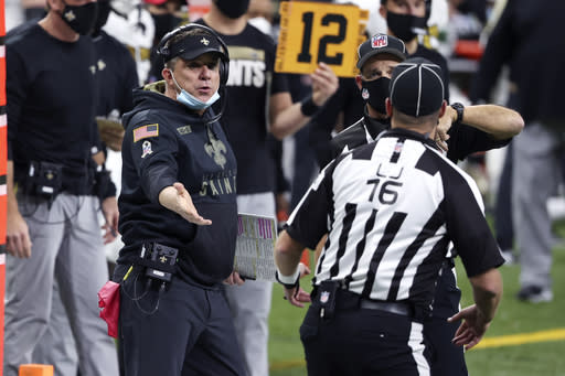 New Orleans Saints head coach Sean Payton talks to line judge Kevin Codey (16) in the first half of an NFL football game against the Minnesota Vikings in New Orleans, Friday, Dec. 25, 2020. (AP Photo/Butch Dill)