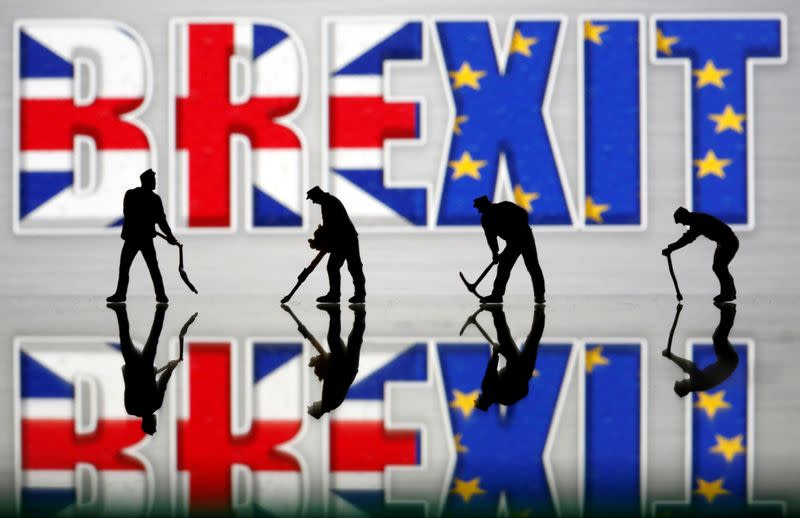 Small toy figures are seen in front of a Brexit logo in this illustration picture