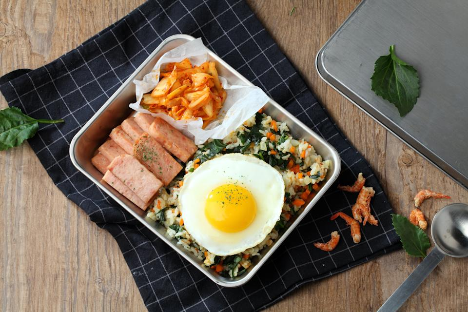A traditional Korean lunch box of kimchi, Spam and fried rice, whichViv Lee ate for breakfast as a child. (Photo: studio416 / Imazins via Getty Images)