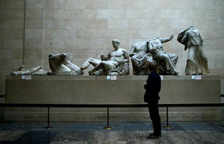 FILE PHOTO: A man looks at the Parthenon Marbles, a collection of stone objects, inscriptions and sculptures, also known as the Elgin Marbles, on show at the British Museum in London October 16, 2014. REUTERS/Dylan Martinez/File Photo