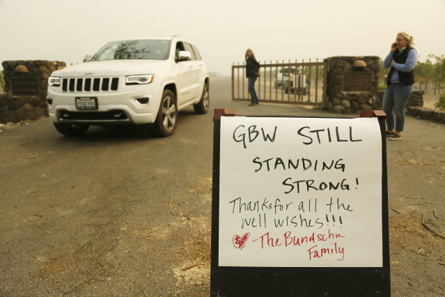 <p>A sign tells people that the historic Gundlach Bundschu Winery is still standing, Tuesday, Oct. 10, 2017, in this view near Sonoma, Calif. Workers in Northern California's renowned wine country picked through charred debris and weighed what to do with pricey grapes after wildfires swept through lush vineyards and destroyed at least two wineries and damaged many others. (Photo: Eric Risberg/AP) </p>
