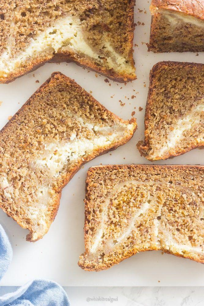 """<p>One of the best ways to keep banana bread moist and rich? A layer of cream cheese. NOM.</p><p><strong>Get the recipe at <a href=""""https://whiskitrealgud.com/cream-cheese-banana-bread-3/"""" rel=""""nofollow noopener"""" target=""""_blank"""" data-ylk=""""slk:Whisk It Real Gud"""" class=""""link rapid-noclick-resp"""">Whisk It Real Gud</a>.</strong></p><p><a class=""""link rapid-noclick-resp"""" href=""""https://www.amazon.com/USA-Pan-1140LF-Bakeware-Aluminized/dp/B0029JQEIC/?tag=syn-yahoo-20&ascsubtag=%5Bartid%7C10050.g.35246097%5Bsrc%7Cyahoo-us"""" rel=""""nofollow noopener"""" target=""""_blank"""" data-ylk=""""slk:SHOP LOAF PANS"""">SHOP LOAF PANS</a><br></p>"""