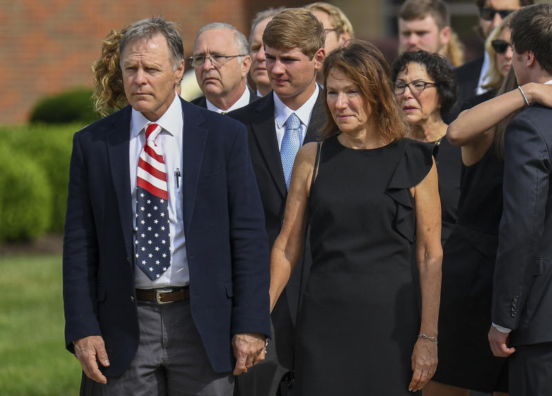 """FILE - In this June 22, 2017, file photo, Fred and Cindy Warmbier watch as their son Otto's casket is placed in a hearse after his funeral Wyoming, Ohio. The Warmbier's have spoke out Friday, March 1, 2019, after President Donald Trump's comment this week that he takes North Korea's leader Kim Jong Un """"at his word"""" that he was unaware of alleged mistreatment during their son's 17 months of captivity. Warmbier died at age 22 soon after his return in June 2017. (AP Photo/Bryan Woolston, File)"""