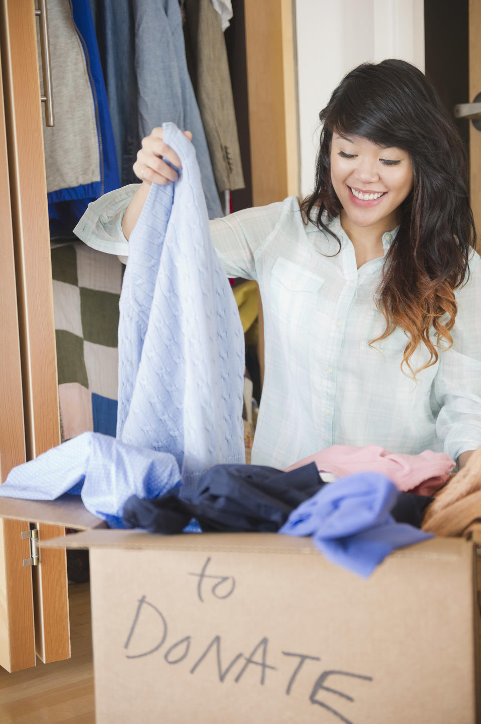 Donating clothes is a good way to feel good about getting rid of items. Photo: Getty