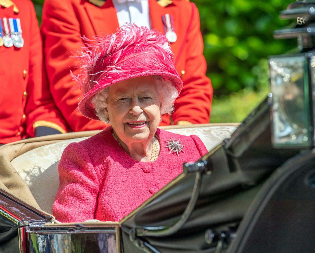 <p>Queen Elizabeth chose a vibrant pink ensemble for the races today.</p>