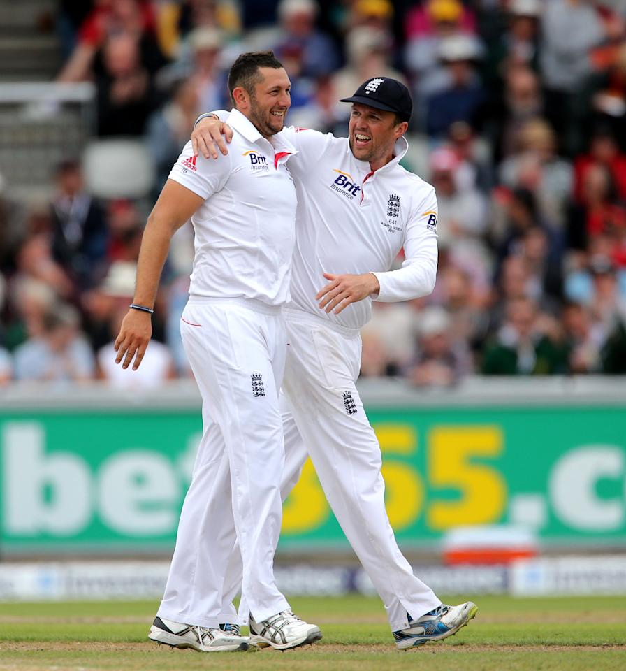 England bowler Tim Bresnan celebrates with Graeme Swann after taking the wicket of Australia batsman Shaun Watson, during day four of the Third Investec Ashes test match at Old Trafford Cricket Ground, Manchester.