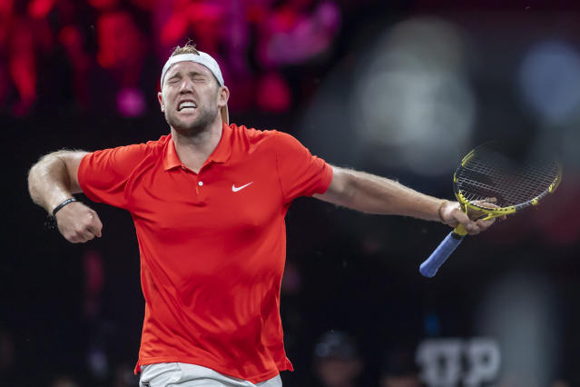 Team World's Jack Sock celebrates after winning a game against Team Europe's Fabio Fognini at the Laver Cup tennis event, in Geneva, Switzerland, Friday, Sept. 20, 2019. (Martial Trezzini/Keystone via AP)