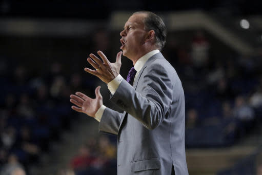 East Carolina coach Jo Dooley talks to his team during the first half of an NCAA college basketball game against Navy at the Veterans Classic Tournament, Friday, Nov. 8, 2019, in Annapolis, Md. (AP Photo/Julio Cortez)