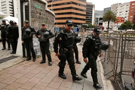 Police guard in front of  the Electoral National Council  (CNE) headquarters prior to Sunday presidential election in Quito, Ecuador, April 1, 2017. REUTERS/Mariana Bazo