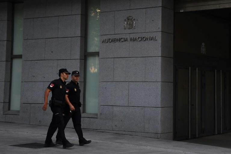 Spanih policemen walk in front of the National Court in Madrid