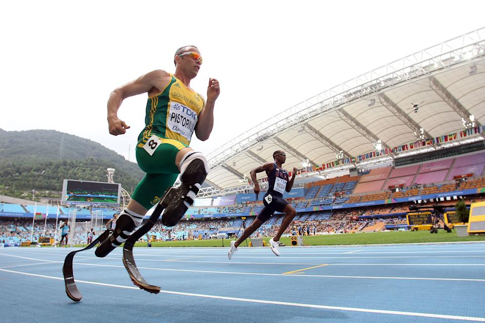 """<b>Against the odds</b><br><br>South African runner Oscar Pistorius is headed to the London Olympics and will become the first amputee track athlete to compete at the games. He was selected to run both the 400 and 4x400 relay by South Africa's Olympic committee on July 4. """"Today is really one of the happiest days of my life!"""" he wrote on Twitter. (Michael Steele/Getty Images)"""