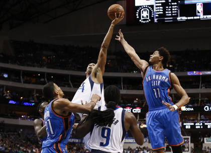 Can Jeremy Lamb (right) and Andre Roberson play more meaningful roles this year? (AP/Jim Cowsert)