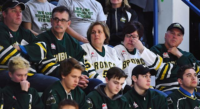 Mourners attend a vigil at the Elgar Petersen Arena, home of the Humboldt Broncos. (Jonathan Hayward/CP)