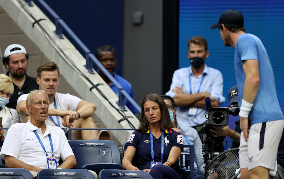 Andy Murray (pictured right) argues with former chair umpire Gerald Armstrong (pictured left) during his US Open singles first round match.