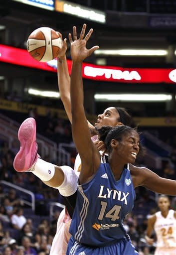 Minnesota Lynx's Devereaux Peters (14) battles Phoenix Mercury's Candice Dupree for a rebound during the first half of a WNBA basketball game Friday, Sept. 21, 2012, in Phoenix.(AP Photo/Ross D. Franklin)