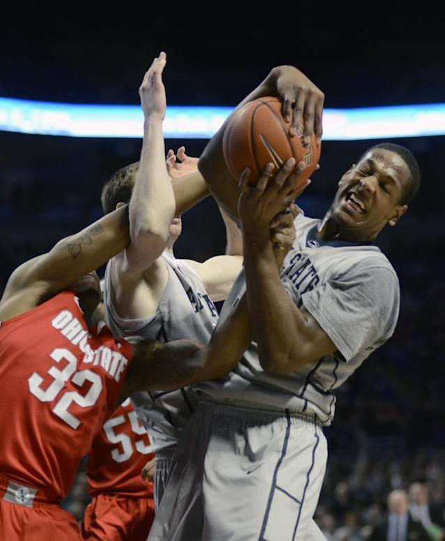 Penn State's Jordan Dickerson, right, grabs a rebound during the first half of an NCAA college basketball game on Thursday, Feb. 27, 2014, in State College, Pa. (AP Photo/Ralph Wilson)