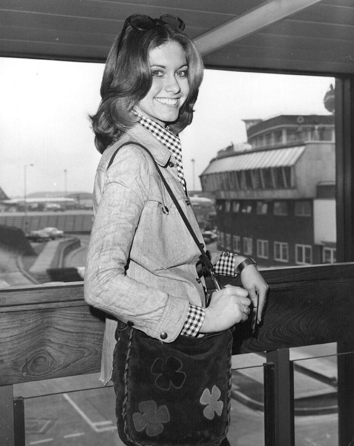 <p>Up-and-coming actress, Olivia Newton-John, hit the scene rocking shoulder-length hair with a center part and just the right amount of curl on the ends.</p>