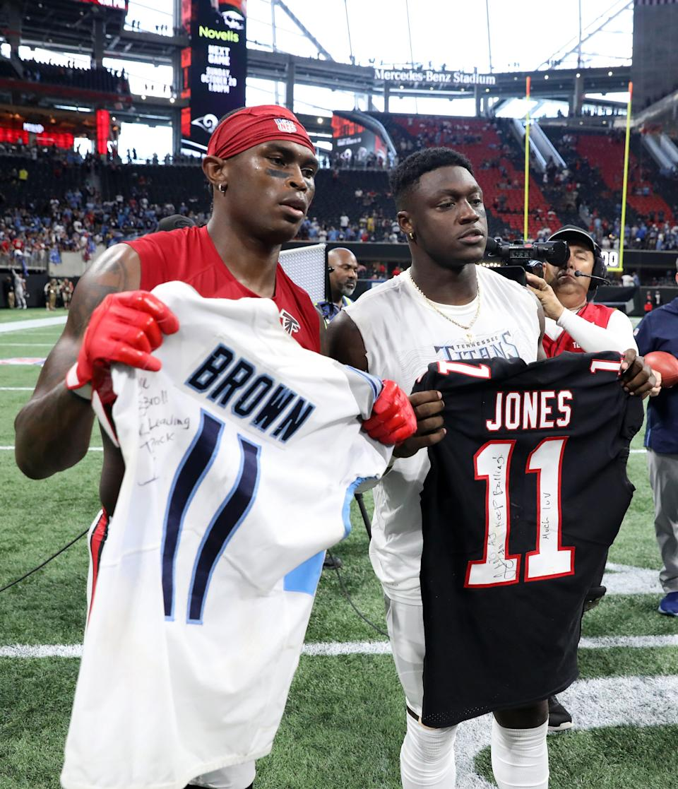 Julio Jones, left, joins Titans WR A.J. Brown in Tennessee ... though only one will get to wear No. 11.