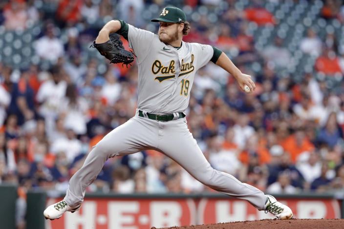 Oakland Athletics starting pitcher Cole Irvin winds up during the first inning of the team's baseball game against the Houston Astros on Thursday, April 8, 2021, in Houston. (AP Photo/Michael Wyke)