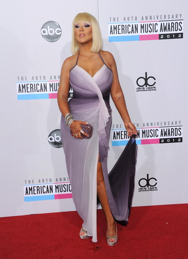 AMAs 2012: We love Christina Aguilera but we think her fashion has gone off the boil recently. We're not a fan of this halter neck dress or the OTT spray tan. We are, however, very glad she's ditched the red dip dye hair in favour of this chic bob and fringe. Copyright [WENN]