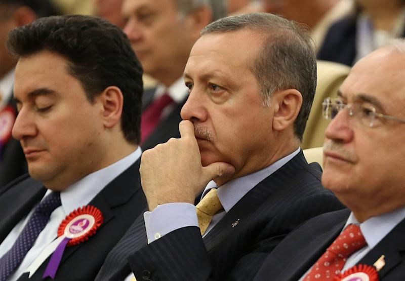 Turkey's Deputy Prime Minister Ali Babacan (L) and Prime Minister Recep Tayyip Erdogan (C)take part in a ceremony marking the 52nd anniversary of Turkey's Constitutional Court, on April 25, 2014 in Ankara (AFP Photo/Adem Altan)