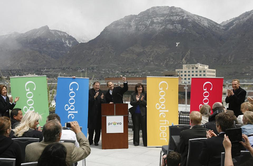 Mayor John Curtis, center, along with Gov. Gary Herbert, left, and Rebecca Lockhart, makes the announcement that Google will make Provo, Utah, the third city to get its high-speed Internet service via fiber-optic cables, Wednesday, April 17, 2013 in Provo. The Provo deal is the first time Google plans to acquire an existing fiber-optic system. The city of 115,000 created the fiber-optic network, iProvo, in 2004, which has struggled to break even. (AP Photo/The Salt Lake Tribune, Rick Egan) DESERET NEWS OUT; LOCAL TV OUT; MAGS OUT