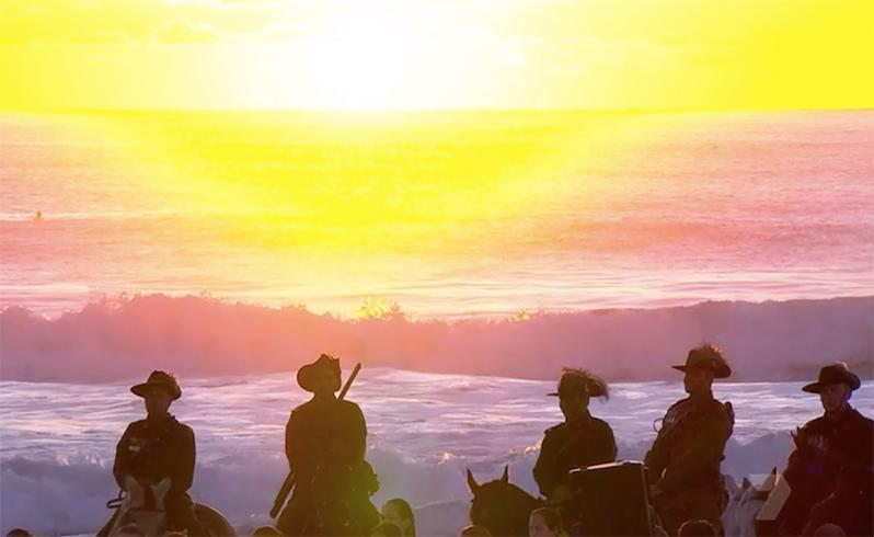 The rising sun greets the light horsemen as they stand guard along the shores of the Gold Coast. Source: AAP