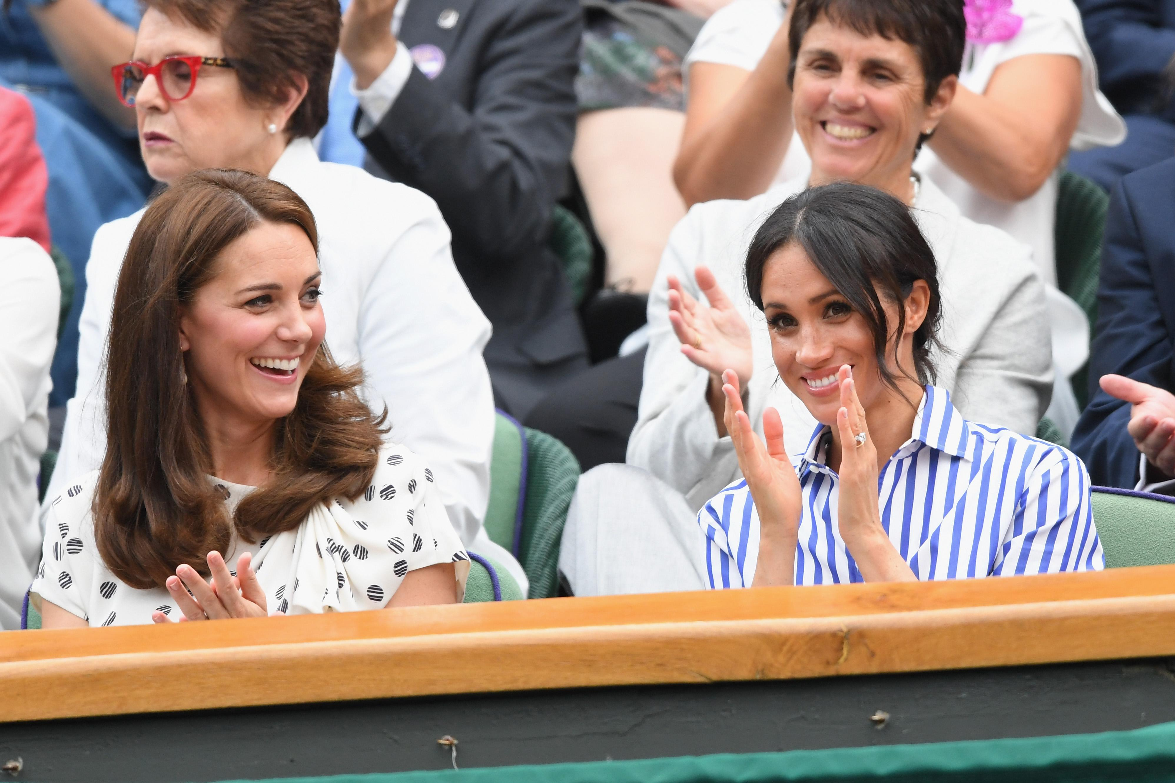 LONDON, ENGLAND - JULY 14: Catherine, Duchess of Cambridge and Meghan, Duchess of Sussex attend day twelve of the Wimbledon Tennis Championships at the All England Lawn Tennis and Croquet Club on July 13, 2018 in London, England. (Photo by Karwai Tang/WireImage )