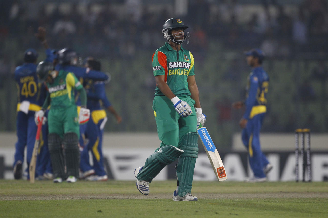 Bangladesh's Shakib Al Hasan, center, walks back to the pavilion after his dismissal by Sri Lanka's Ashan Priyanjan during their second one-day international (ODI) cricket match in Dhaka, Bangladesh, Thursday, Feb. 20, 2014. (AP Photo/A.M. Ahad)